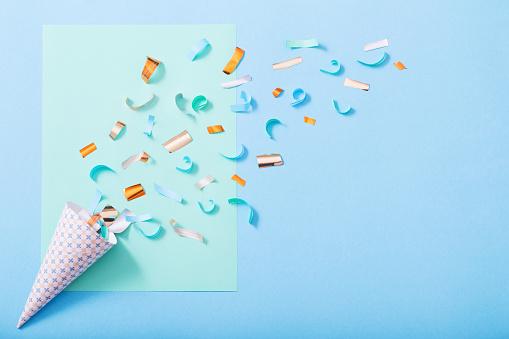 Confetti on paper background