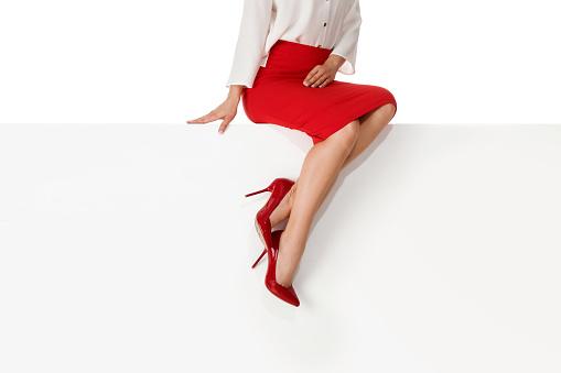 Legs woman wearing high heels shoes