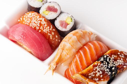 various sushi on white background