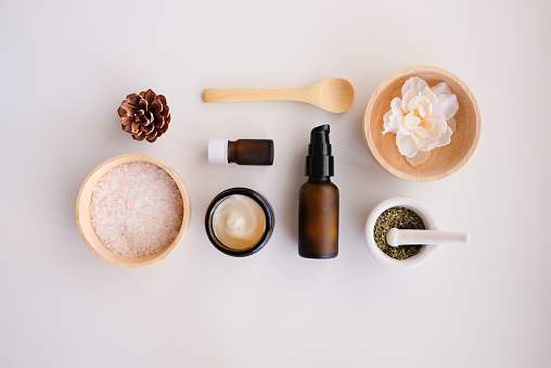 Beauty cosmetic skincare background .Products with flower ,leaves on table top view, flat lay.minimal modern