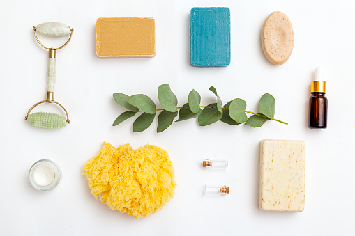 Eucalyptus and natural skin care products on white background.  Flat lay