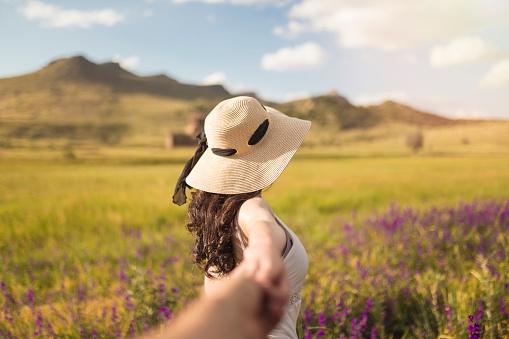 beautiful woman among lavender flowers
