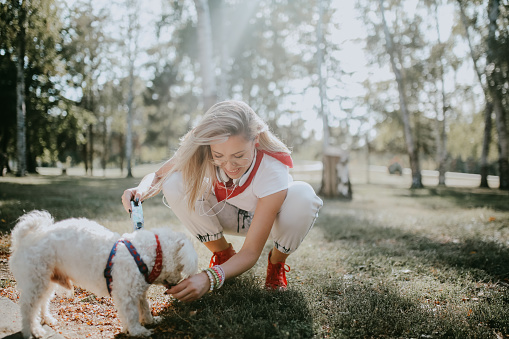 walk with her dog in the park