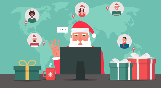 Modern Santa Claus sitting and using computer connecting to people around the world