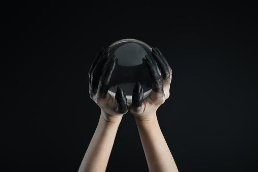 Hands in black paint