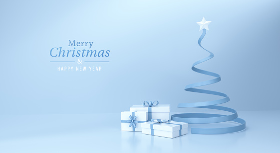 Gift box and christmas tree with a star at the top on blue background and text merry christmas & happy new year.