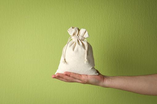 Hand holding cotton bag