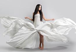 Beautiful girl in flying white dress